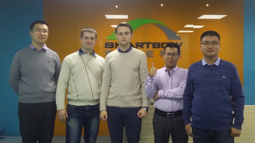 Sergey Vasukevich and Roman Tolkach with Smartbow colleagues