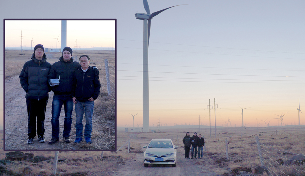 Sergey Vasukevich with Smartbow colleagues and the view of the wind farm